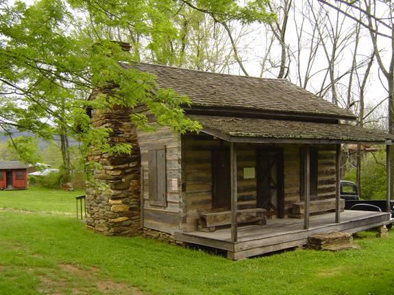 Log Cabin Hewn by John Payne