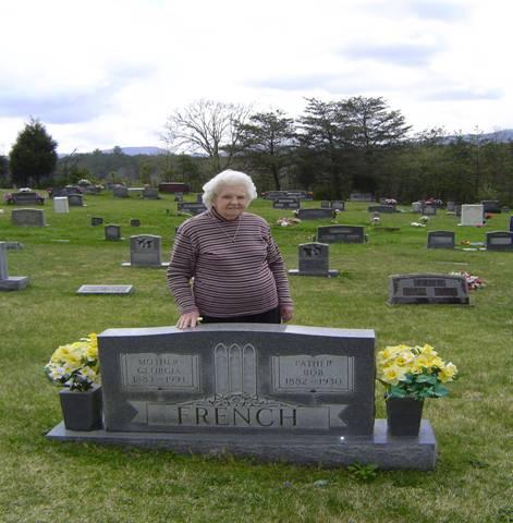 Mrs. Farmer at parents' graves
