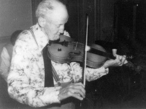 George Lee Hawkins playing the fiddle