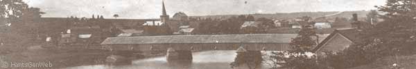 A view of Shubenacadie, Nova Scotia, and covered bridge over the river, circa 1905.