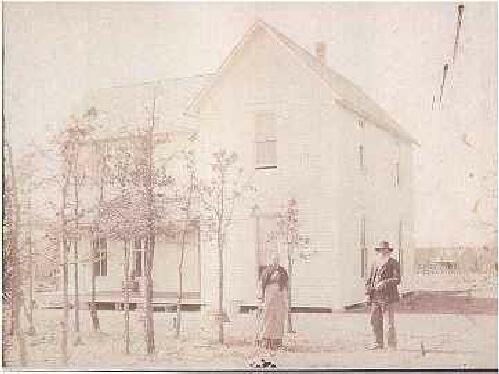 James and Emma Purvis in front of their home